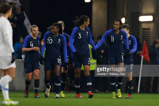 France's MarieAntoinette Katoto is congratulated by teammates after scoring a goal during a women's friendly football match between France and USA at...
