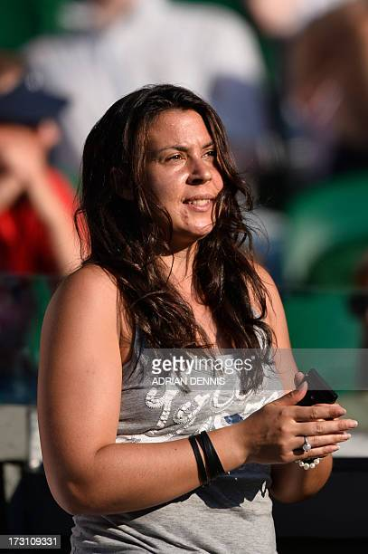 France's Marion Bartoli applauds as she watches the mixed doubles final between Canada's Daniel Nestor and France's Kristina Mladenovic and Brazil's...