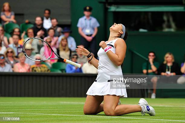 France's Marion Bartoli celebrates beating Belgium's Kirsten Flipkens during their women's singles semifinal match on day ten of the 2013 Wimbledon...