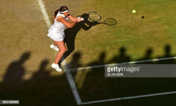 France's Marion Bartoli returns in her doubles match with Slovakia's Daniela Hantuchova on the eighth day of the 2018 Wimbledon Championships at The...