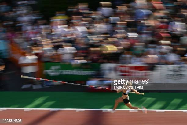 France's Marion Lotout competes during a women's pole vaulting exhibition street event of the Diamond League athletics meeting Athletissima on...
