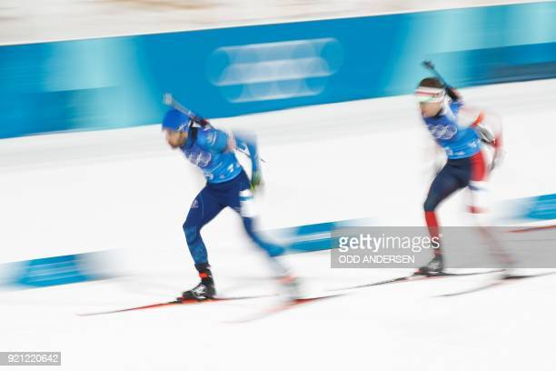 France's Martin Fourcade and Norway's Emil Hegle Svendsen compete in the mixed relay biathlon event during the Pyeongchang 2018 Winter Olympic Games...
