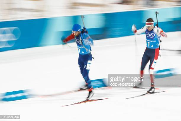 TOPSHOT France's Martin Fourcade and Norway's Emil Hegle Svendsen compete in the mixed relay biathlon event during the Pyeongchang 2018 Winter...