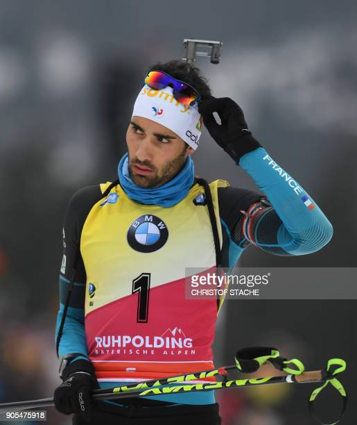France's Martin Fourcade arrives for the warmup shooting prior the men's 15 kilometer mass start competition at the Biathlon World Cup on January 14...