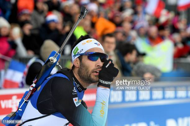 France's Martin Fourcade celebrates after placing seventh during the men's 12,5 km pursuit race event at the IBU World Cup Biathlon 3 in Le Grand...