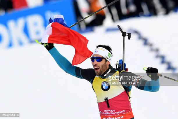 France's Martin Fourcade celebrates after winning the 15 km men's Mass Start event during the IBU World Cup Biathlon 3 in Le Grand Bornand on...