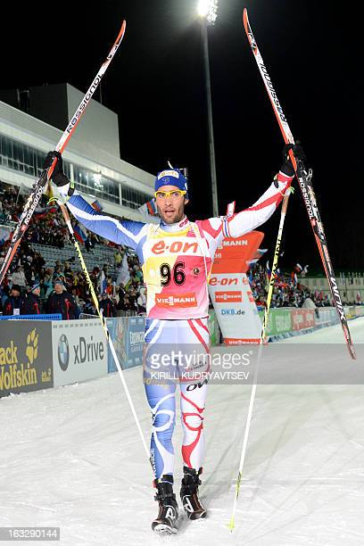 France's Martin Fourcade celebrates his first place in Men 20 km Individual race during IBU World Cup Biathlon at Laura Cross Country and Biathlon...