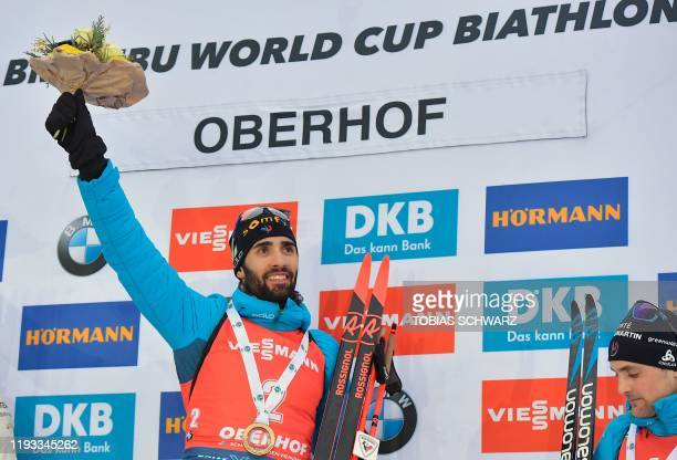 France's Martin Fourcade celebrates on the podium after wining the men's 15km Mass Start event during the IBU Biathlon World Cup in Oberhof, central...