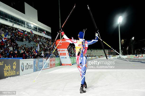 France's Martin Fourcade celebrates placing first in the Men's 20 km Individual race of the IBU World Cup Biathlon at Laura Cross Country and...