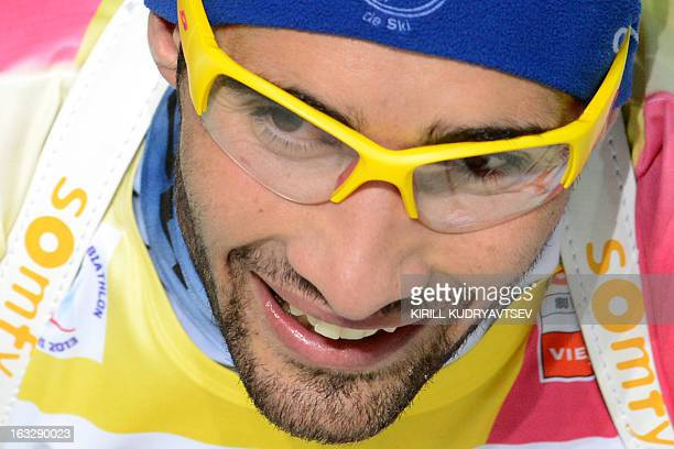 France's Martin Fourcade celebrates while winning the Men 20 km Individual race of IBU World Cup Biathlon at Laura Cross Country and Biathlon Center...