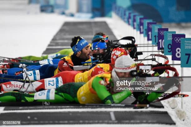 TOPSHOT France's Martin Fourcade competes at the shooting range in the men's 4x75km biathlon event during the Pyeongchang 2018 Winter Olympic Games...