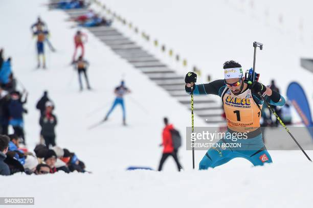 France's Martin Fourcade competes during the mass start Premanon French Biathlon Championships on March 31 2018 in Premanon / AFP PHOTO / SEBASTIEN...