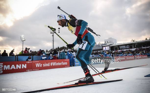 France's Martin Fourcade competes during the Men 15km Mass Start Competition event at the IBU Biathlon World Cup Final in Tyumen on March 25 2018...