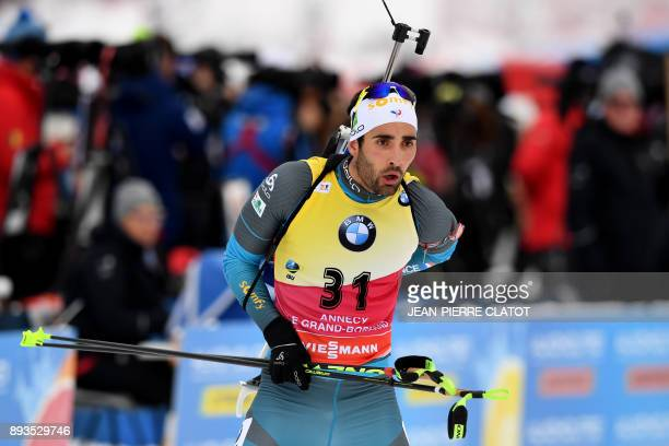 France's Martin Fourcade competes during the men's 10 km sprint event at the IBU World Cup Biathlon in Grand Bornand on December 15 2017 / AFP PHOTO...