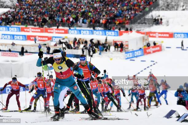 France's Martin Fourcade competes in the 15 km men's Mass Start event during the IBU World Cup Biathlon 3 in Le Grand Bornand on December 17, 2017. /...