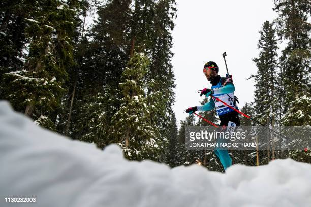 France's Martin Fourcade competes in the men's 20km individual event at the IBU Biathlon World Championships in Ostersund Sweden on March 13 2019
