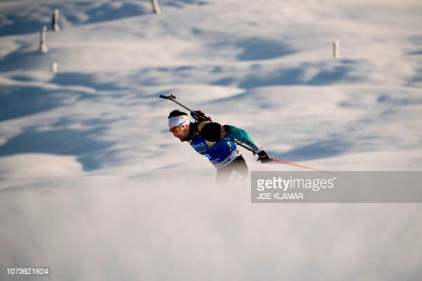 TOPSHOT France's Martin Fourcade competes to win the men's 125 km pursuit event of the IBU Biathlon World Cup in Hochfilzen Austria on December 15...