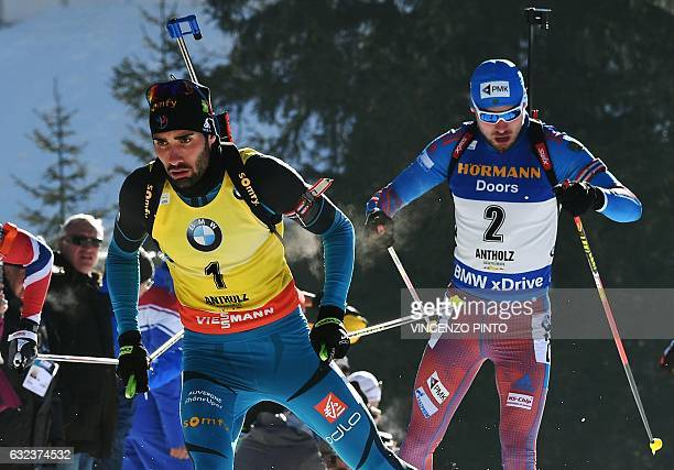 France's Martin Fourcade competes with Russia's Anton Shipulin during the men's 15 km mass start competition of the IBU Biathlon World Cup in...