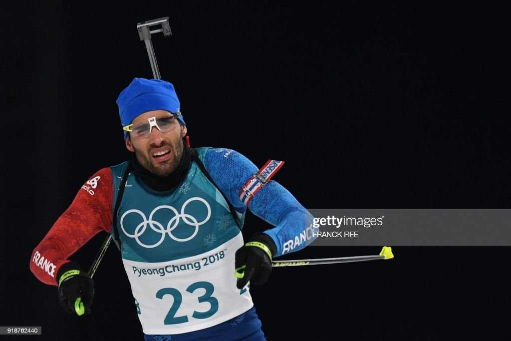 TOPSHOT - France's Martin Fourcade crosses the finish line of the men's 20km individual biathlon event during the Pyeongchang 2018 Winter Olympic Games on February 15, 2018, in Pyeongchang. /