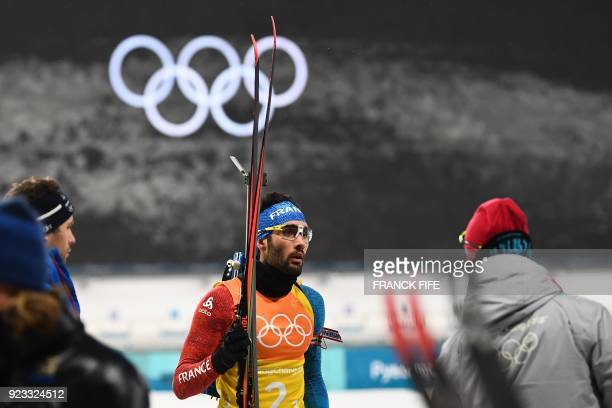 France's Martin Fourcade finishes his relay in the men's 4x75km biathlon relay event during the Pyeongchang 2018 Winter Olympic Games on February 23...