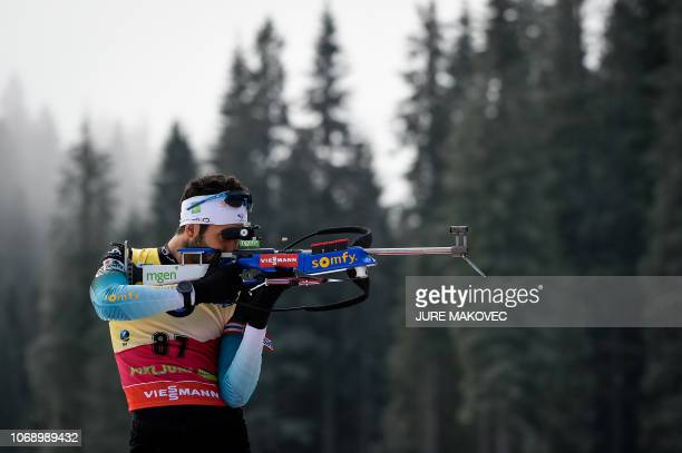 France's Martin Fourcade fires his rifle during the zeroing session prior to the IBU Biathlon World Cup Men's 20km Individual competition in Pokljuka...