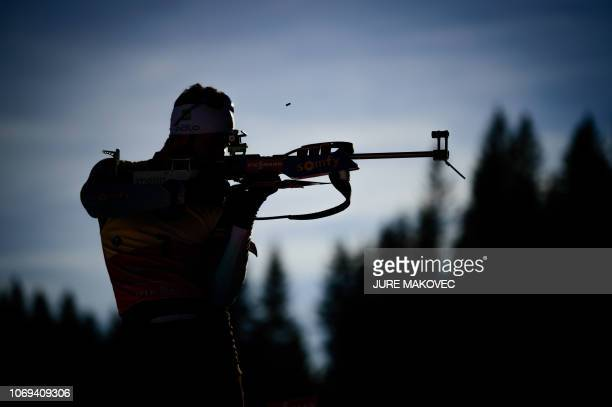France's Martin Fourcade fires his rifle during the zeroing session prior to the IBU Biathlon World Cup Men's 10km Sprint competition in Pokljuka,...