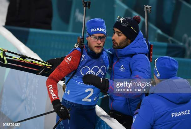TOPSHOT France's Martin Fourcade greets France's Antonin Guigonnat as he crosses the finish line in the men's 4x75km biathlon relay event during the...