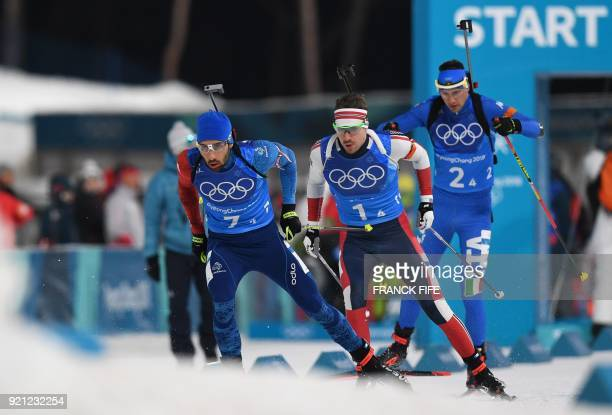 France's Martin Fourcade Norway's Emil Hegle Svendsen and Italy's Dominik Windisch compete in the mixed relay biathlon event during the Pyeongchang...