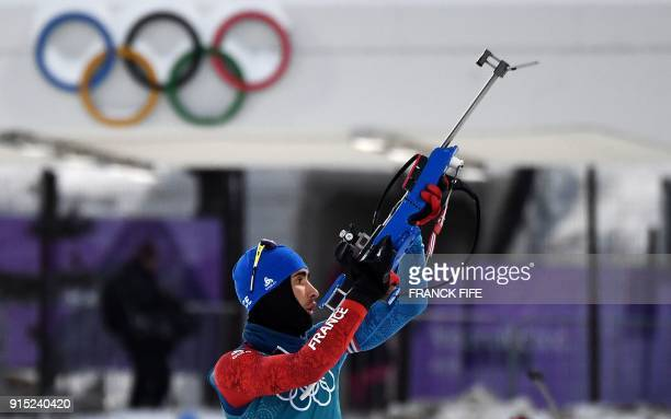 TOPSHOT France's Martin Fourcade prepares to shoot during a free practice session ahead of the Pyeongchang 2018 Winter Olympic Games in Pyeongchang...