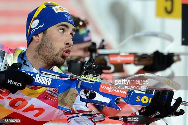 France's Martin Fourcade prepares to shoot during the Men's 20 km Individual race of the IBU World Cup Biathlon at Laura Cross Country and Biathlon...