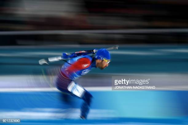TOPSHOT France's Martin Fourcade races to cross the finish line to win gold in the mixed relay biathlon event during the Pyeongchang 2018 Winter...