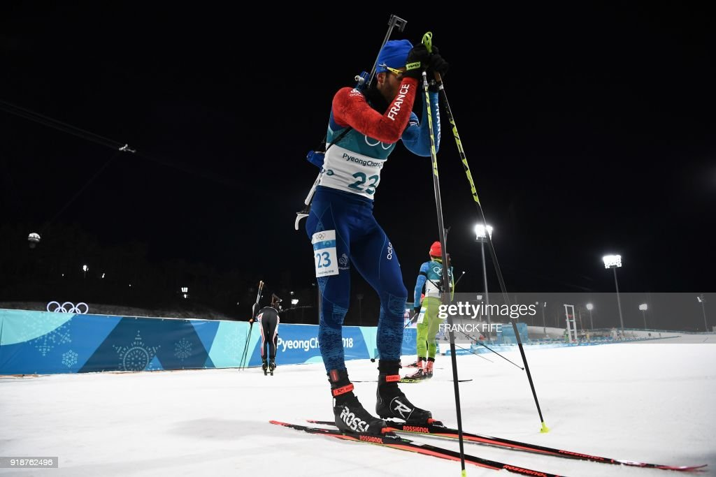 TOPSHOT - France's Martin Fourcade reacts after crossing the finish line of the men's 20km individual biathlon event during the Pyeongchang 2018 Winter Olympic Games on February 15, 2018, in Pyeongchang. /