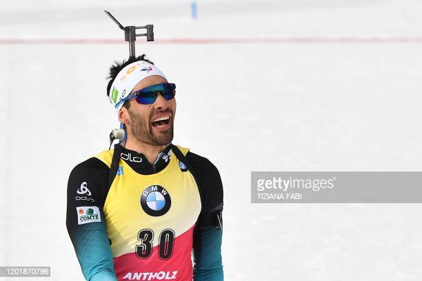 France's Martin Fourcade reacts after crossing the finish line to win the IBU Biathlon World Cup Men's 20km Individual competition in RasenAntholz...