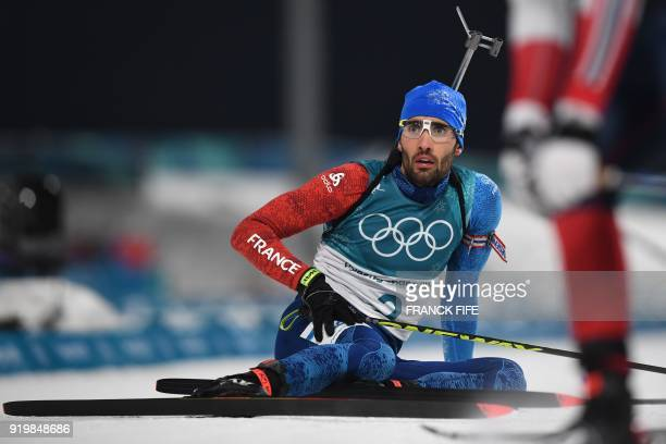 TOPSHOT France's Martin Fourcade reacts as he waits for the results after crossing the finish line in the men's 15km mass start biathlon event during...