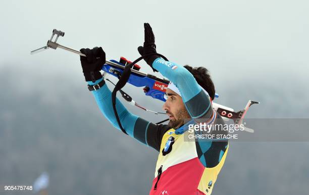 France's Martin Fourcade shoots during the warmup shooting prior the men's 15 kilometer mass start competition at the Biathlon World Cup on January...