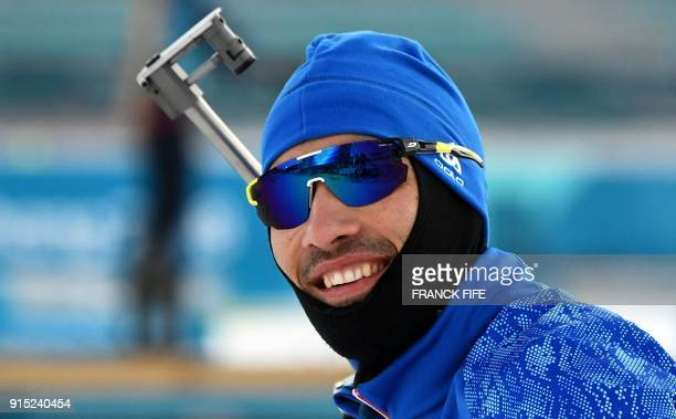 France's Martin Fourcade smiles during a free practice session ahead of the Pyeongchang 2018 Winter Olympic Games in Pyeongchang on February 7 2018 /...
