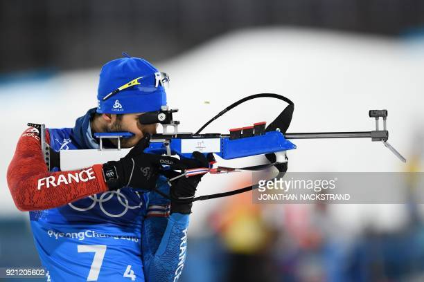 TOPSHOT France's Martin Fourcade warms up at the shooting range prior ot the mixed relay biathlon event during the Pyeongchang 2018 Winter Olympic...