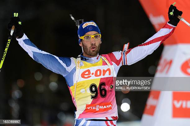 France's Martin Fourkade celebrates while winning the Men 20 km Individual race of IBU World Cup Biathlon at Laura Cross Country and Biathlon Center...