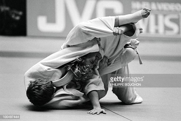 France's Martine Rottier tries to strangle Inger Lise Solheim of Norvegia during the world championship final in judo on December 4 in Paris Martine...