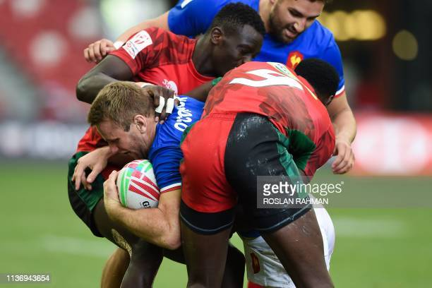 France's Marvin O'Connor fights for the ball during the Singapore Rugby Sevens quarter-final match between France and Kenya in Singapore on April 14,...