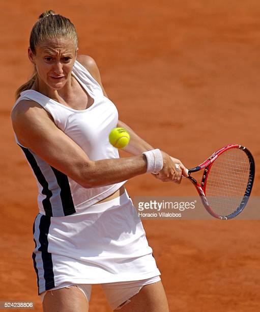 France's Mary Pierce returns the ball to Russia's Ellena Likhovtseva during their semifinal match of the French Open tennis tournament at the Roland...