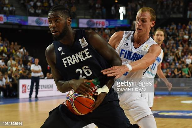 France's Mathias Lessort fights for the ball with Finland's Alex Murphy during the 2019 FIBA Basketball World Championship European qualifying group...