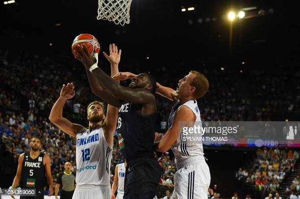 France's Mathias Lessort fights for the ball with Finland's Alexander Murphy and Matti Nuutinen during the 2019 FIBA Basketball World Championship...