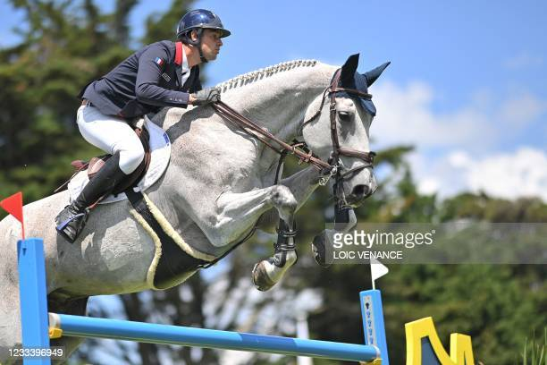 France's Mathieu Billot rides Quel Filou 13 during the Longines FEI Jumping Nations Cup of France, in La Baule, western France, on June 11, 2021. -...