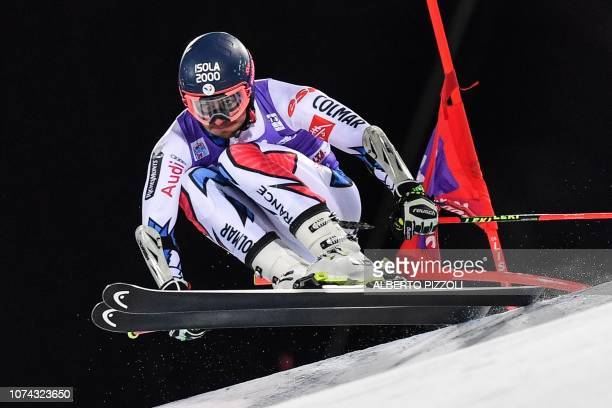 France's Mathieu Faivre competes in the 1/16th final of the FIS Alpine World Cup Men's Parallel Giant Slalom nightrace on December 17, 2018 in Alta...