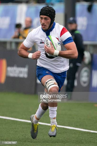 France's Mathieu Hirigoyen runs with the ball during the World Rugby U20 Championship match between France and South Africa at Racecourse Stadium in...