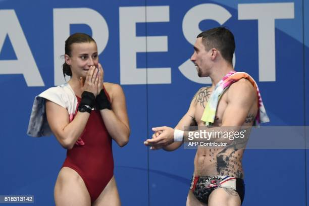 France's Matthieu Rosset and Laura Marino react after winning the 3m/10m team event during the diving competition at the 2017 FINA World...