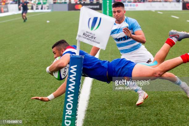 France's Matthis Lebel scores a try during the World Rugby U20 Championship match between France and Argentina at the Racecourse Stadium in Rosario,...