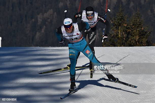 France's Maurice Magnificat and Switzerland's Roman Furger compete in the Men's 10 km individual free competition of the Tour de Ski Cross Country...
