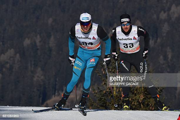 """France's Maurice Magnificat and Switzerland's Roman Furger compete in the Men's 10 km individual free competition of the """"Tour de Ski"""" Cross Country..."""